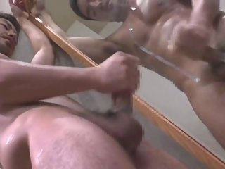 sexy man cum on mirror